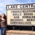 Samantha Kowalski (12) and Mary Beggs (12) stand in front of Lake Central's sign which recognizes their achievement as National Merit Scholar semi-finalists.  The two girls are the only ones at Lake Central to receive this honor this year.