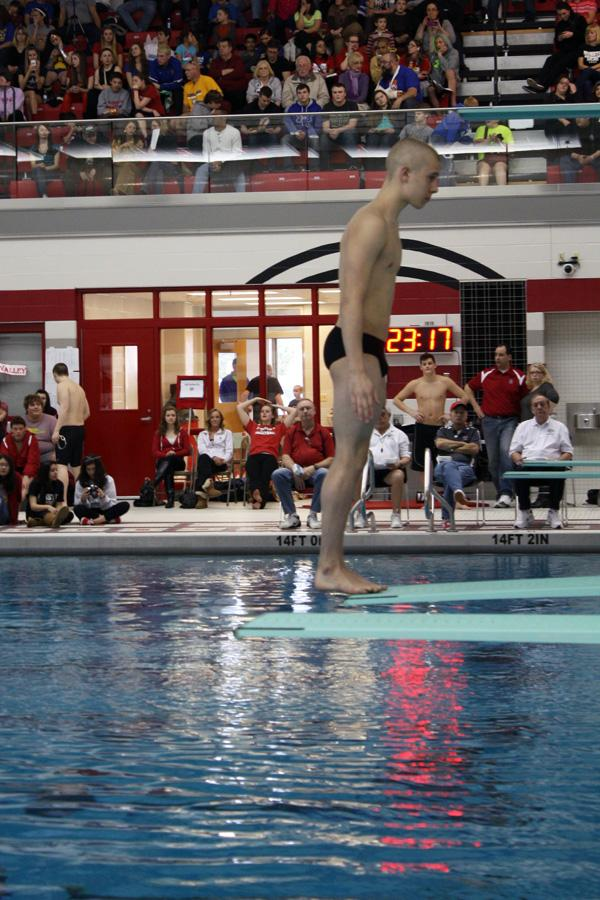 Alexander Morgan (10) prepares to do an inward double tuck at Sectionals. Morgan won the Sectional Title after coming in 12th the previous year.
