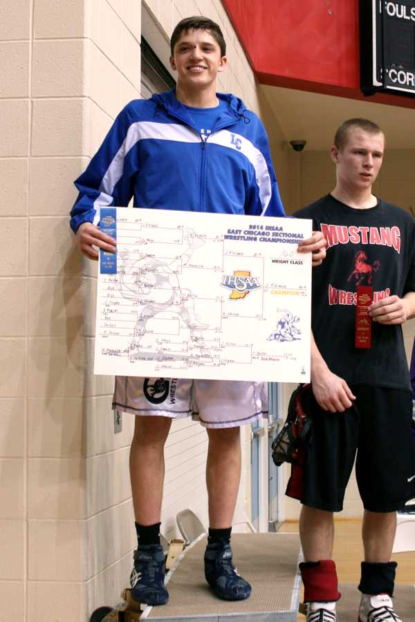 Jacob Kleimola (10) shows off his winning bracket and first place ribbon. Kleimola won his first Sectional Championship at the 160 weight class.