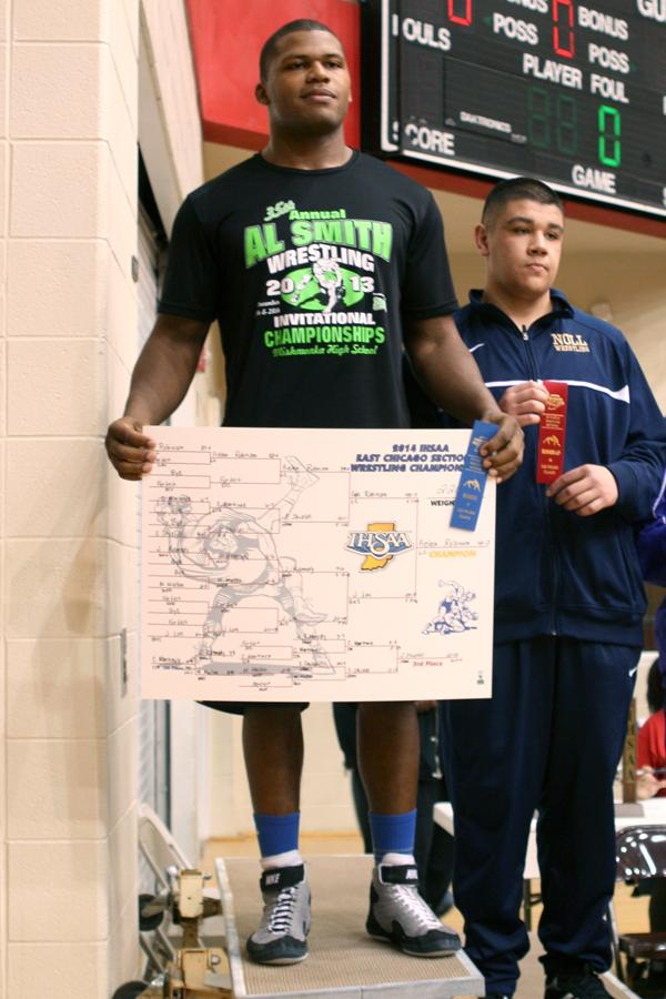 Gelen Robinson (12) stands at the winning spot on the podium. Robinson has won an individual Sectional Championship three times.