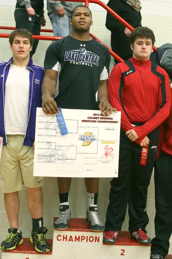 Gelen Robinson (12) towers over his opponents on the podium. This was Robinson's third Regional title in a row.