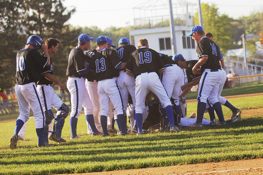 The Indians get up from their dog pile after winning game two. The boys played with a sick pitcher and first baseman.