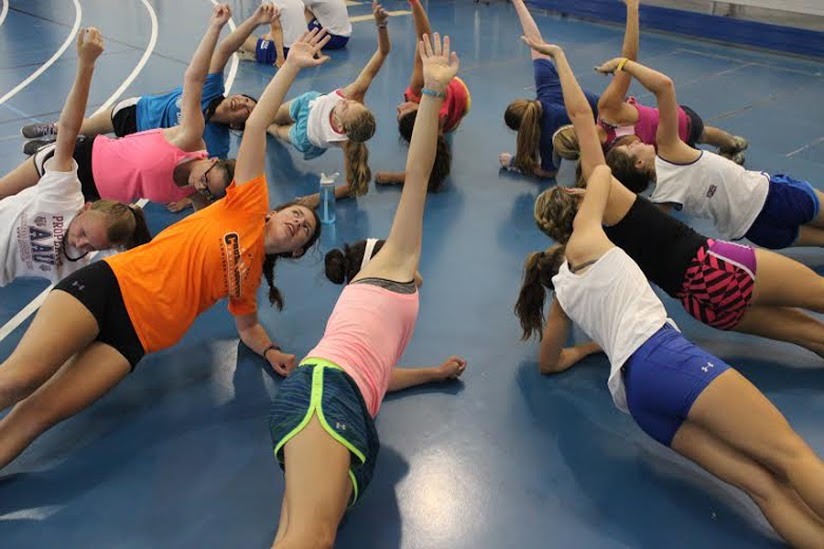 After running, the girls cross country team does other forms of training. They did a lot of core work such as planks and sit-ups for their workout.