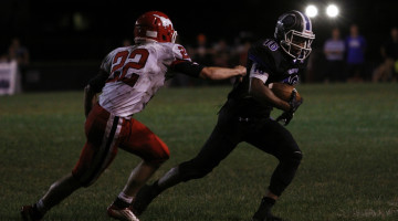 Antwan Davis (12) escapes a Munster defender's grasp. Davis caught nine passes for 95 yards during the LC-Munster square-off on Friday, August 22. Photo by: Cassidy Niewiadomski