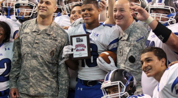 Antwan Davis (12) is awarded Most Valuable Player by the National Guard. Davis snagged two touchdown passes in the Tribe's 14-6 victory over Portage.