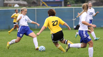 Madison Sarkey (9) passes the ball to a teammate.  This is Sarkey's first year playing for Lake Central.