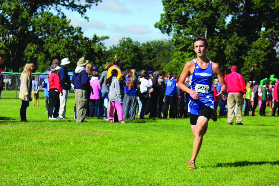 Brian St. John (12) finishes off the varsity race strong.  St. John was one of seven runners from Lake Central in the varsity race.