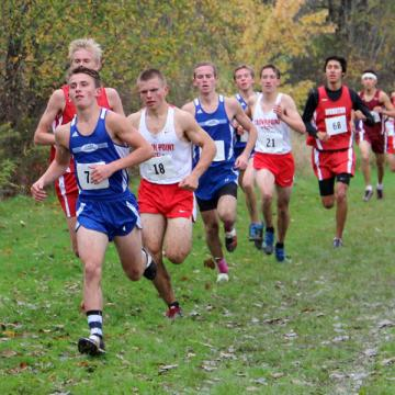 Kameron Konopasek (11) heads the pack of runners around the outer perimeter of the course and into the woods. He finished in 6th place overall  with a time of 17:05.