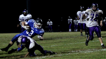 Ryan Voss (9) slides in attempt to run the ball into the endzone. The next game was scheduled for Saturday, Oct. 18.