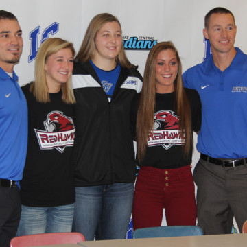 Girls basketball coaches, Mr. Andy Gurnak and Mr. Mark Urban, stand proudly next to their three players who signed to play college ball. Tara Zlotkowski (12) signed with Indiana University Northwest, Lindsay Kusbel (12), Grand Valley State, and Gina Rubino, (12) Indiana University Northwest.