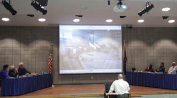 Mr. Bill Ledyard, Director of Facilities, shows the school board members photos of Phase Three of construction. The meeting was held on Nov. 17 in the LGI.