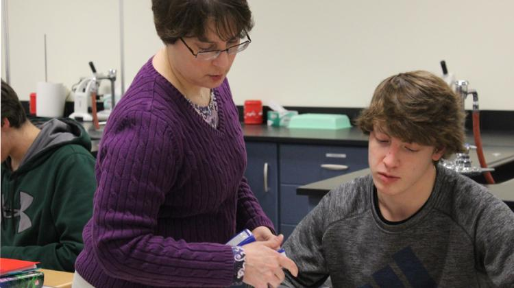 Roberta Harnish, Science, checks her student's homework during her fourth hour class on Dec. 15. Mrs. Harnish teaches Earth Space Science and Honors Anatomy and Physiology.
