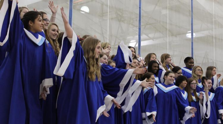 """The Junior Treble Choir ended the song """"Here Comes Santa Claus"""" on an excited note.  The group put on dozens of cheerful facial expressions and hand movements during the song."""