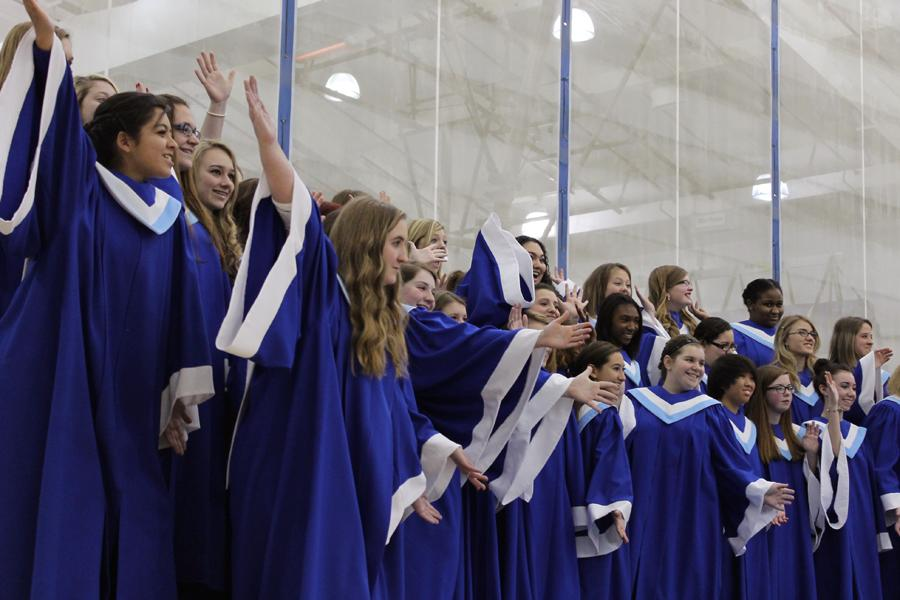 "The Junior Treble Choir ended the song ""Here Comes Santa Claus"" on an excited note.  The group put on dozens of cheerful facial expressions and hand movements during the song."