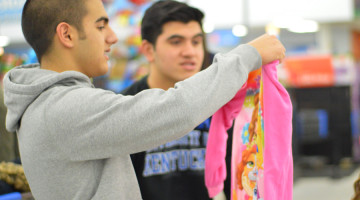 Antonio Gonzalez (10) double checks his gifts before checkout. Angel tree shopping took place on Dec. 11.