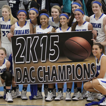 Players from the varsity team celebrate after earning the title of DAC champions in a game against the Valparaiso VIkings. This was the first time in the history of the basketball program that the team was undefeated in the DAC.