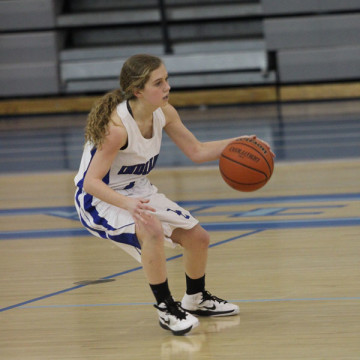 Ashley Todd (9) dribbles the ball before passing it to a teammate.  The tribe began with a strong lead of 20-1 in the first quarter.