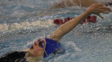 Victoria Springman (11) backstrokes during the meet on Tuesday, Jan. 20. Springman swam a 24.99 second 50 freestyle race.