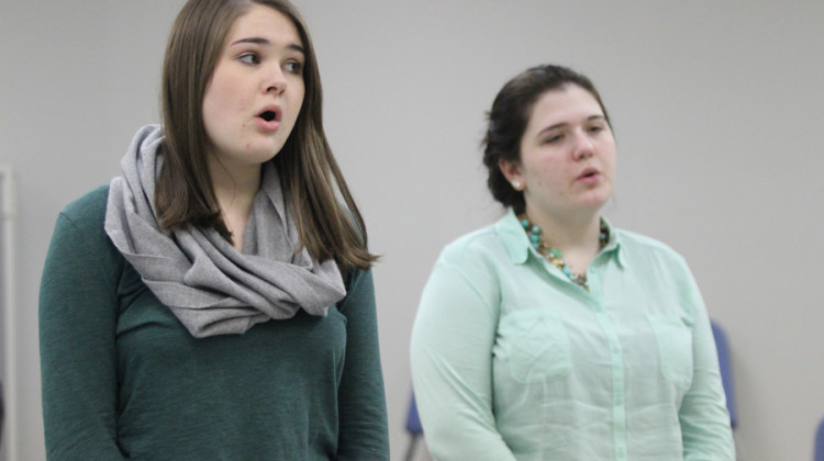 Megan Barry (11) and Tabitha Prowse (12) warm up at the beginning of practice. The thespians warmed up by doing scales and tongue twisters.