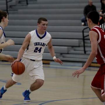Austin Atkins (10) hunts for an open path to the basket as his defenders retreat.  The game was played at Lake Central.