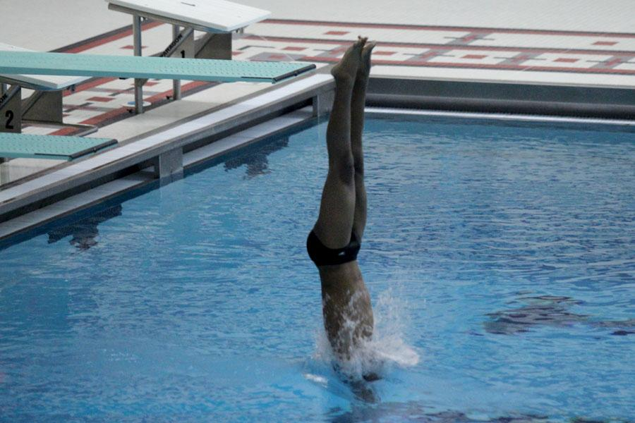 Drake Hunt (10) breaks through the water as straight as a board while he follows through with his dive. Hunt's final score was 232.4.