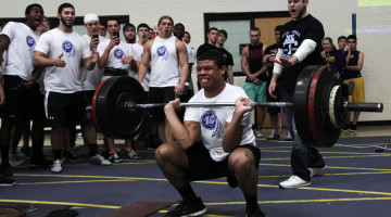Antwan Davis (12) attempts to break a record in the power clean lift. Davis finished in third place behind Brandon Scott (12) who placed second.