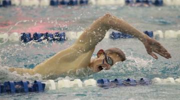 Brandon Walton (11) swims the 50 yard freestyle. Walton also swam in the 100 yard freestyle and the 200 yard freestyle relay.