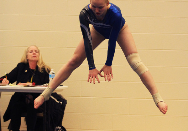 Madison O'Drobinak (9) straddle jumps during her floor routine.  The team competed against Hobart on Tues., Feb. 24.