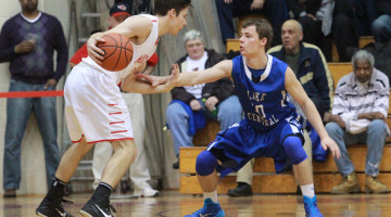Gage Ray (11) guards Andrew Hackett (12) of Munster.  Ray's defense helped calm the Mustang's outside shooting.