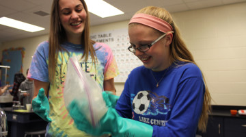 Maja Vidovic (10) and Ashley Scanlon (10) shake a bag filled with salt and ice along with milk, half-and-half and vanilla. The solution created ice cream.
