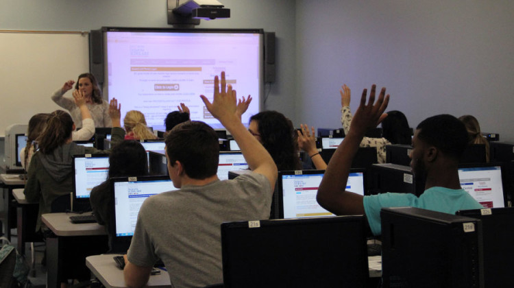 Juniors at the Dollars for Scholars meeting raise their hands to answer a question asked by Ms. Ashley Kline, Guidance.  She informed the students on what information to put in their profiles.