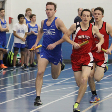 Tyler Kramer-Stephens (11) runs head-to-head with Crown point opponent. This was the boys' first meet on March 11.