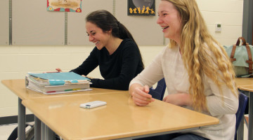 Rachel Gross (11) and Julia Gruver (11) laugh over the discussion at the Junior Class Cabinet meeting. Junior Class Cabinet met on April 15 to discuss Prom.