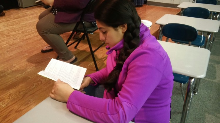 Miranda Munoz (8) reads her script at the first rehearsal. During the rehearsal, most of the time was spent reading through scripts and getting to know each other.