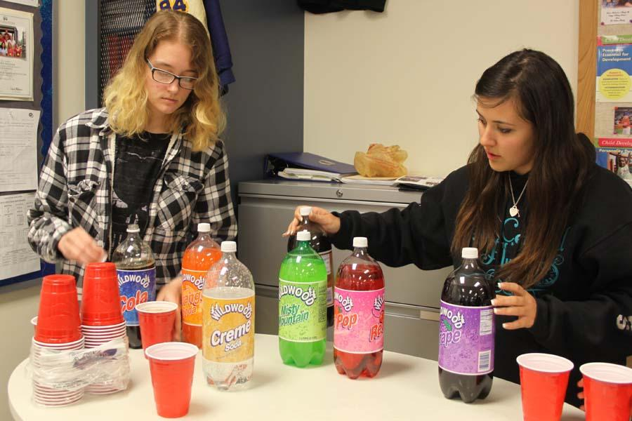 Lana Niewiadomski (10) and Ana Boulas (12) choose the flavor of pop they want. Although many students left before the movie was over, they were all welcome to have as much pizza and pop as they wanted.