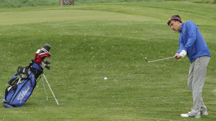 Jordon Lykowski (11) watches after his putt. The boys golf team played against the Crown Point team on May 20.
