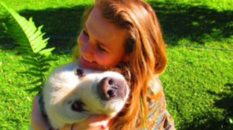 Natalia Kuzbiel (11) embraces her dog Buddy. Along with having a pet dog, Kuzbiel also owns chickens, goats and turkeys.