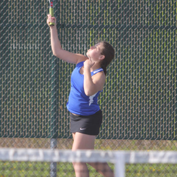 Anna Wachowski (10) serves the ball to her Munster opponent. The matches were not concluded due to a lack of sunlight to last during the prolonged matches.