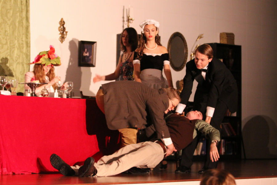 Professor Beasly, played by Jackson DeLisle (12),  and Mortimer, played by William Kruzan (10),  move Mr. Bilkem's dead body to a chair. The characters decided to move his body so they would not lose track of it.