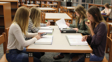 Hannah Mickelson (10), Kayli Cinco (10), Hayley Skrezyna (10), and Morgan Dines (10) gather in the new library to study before school on Wednesday, Sept. 2. Students have been using the library as a quiet study area in the morning.