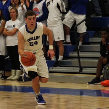 Austin Atkins (11) leads the fastbreak following a steal.  Atkins is one of five juniors playing for varsity this season.