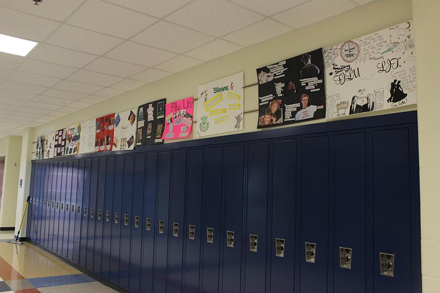 The film literature students finish their quote posters for the class. They were hung up in the hallway for everybody to see.