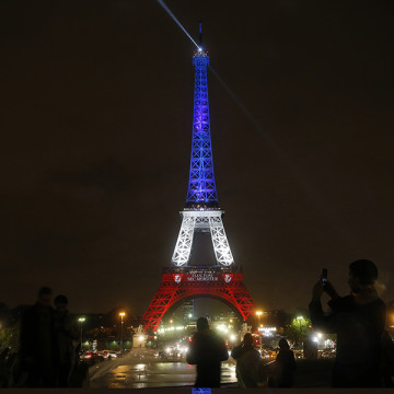 On the third day of national mourning, the Eiffel Tower was lighted in the national colors after going dark on Nov. 16, 2015 in Paris. Used with limited license: Carolyn Cole/Los Angeles Times/TNS.