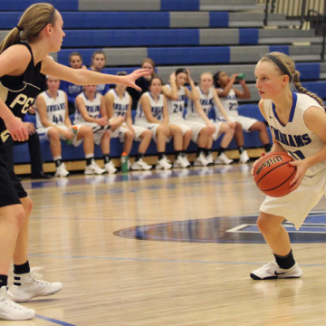 Stephanie Dijak (9) looks for a player to pass the ball to.  The game was their second home game.