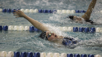 Jillian Murray (9) competes in the 100 backstroke. Murray won the race.