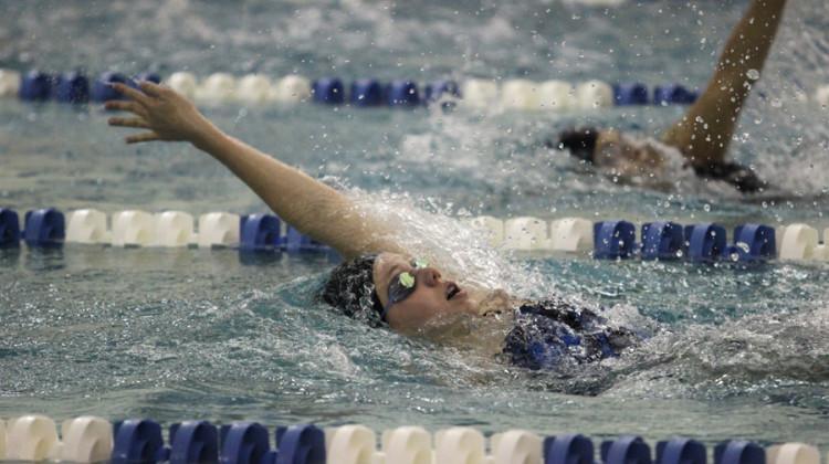 Jillian Murray (9) competes in the 100 backstroke. Murray won the race.