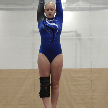 Aislinn Wade (10) performs her beam routine. The team ended with a score of 98.75.