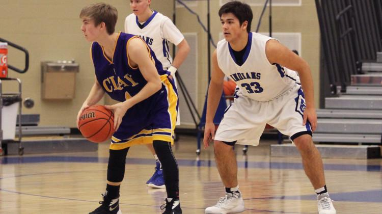 Justin Graciano (10) guards an opponent from Clay High School. The Indians won the game with a final score of 70-19.