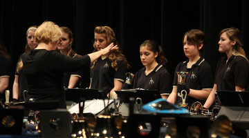 Mrs. Sandy Hobbs, Arts, directs the bells ensemble.  The handbells group from Grimmer Middle School also performed two pieces.