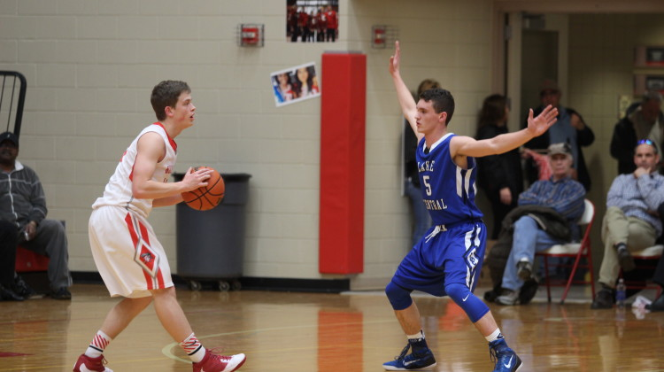 Connor Tomasic (10) stands directly across from a Crown Point player to defend the ball. Tomasic had to make a quick deflect, and was able to return the ball to Lake Central.